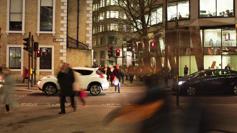 Time-lapse of Pedestrians crossing a road at night Footage