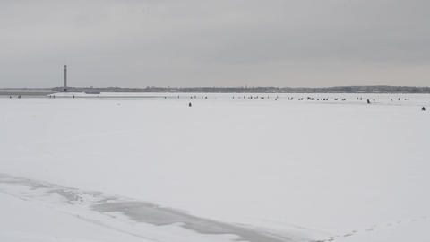Winter fishermen angling on ice Footage