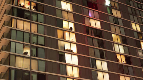 Modern apartment block at night Filmmaterial