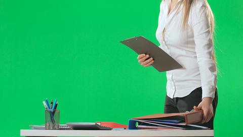 Workflow in the office, secretary keeps folders, green screen, alpha Footage