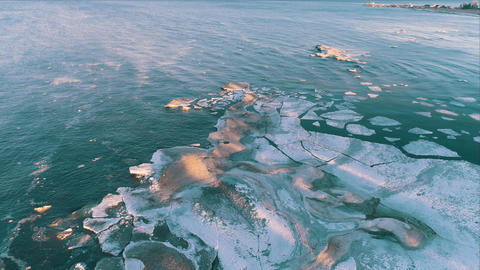 Aerial View Frozen Shapes of Ice Floating on Lake Ladoga, spring time Footage