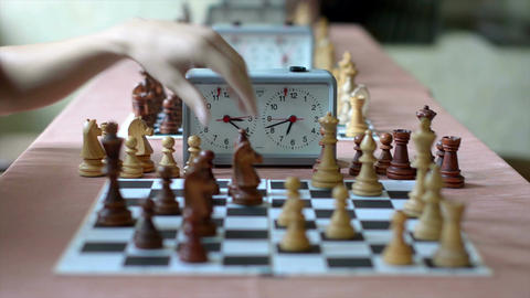 Play in chess, the camera focus on the chess clock Footage