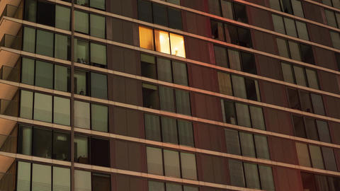 Switching lights on in a single apartment block Live Action