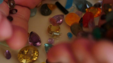 mail hand pour out precious gemstones slow motion 2 Footage