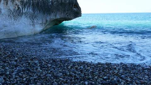 Rocky beach and azure blue waters of the Mediterranean sea. Concept travel Footage
