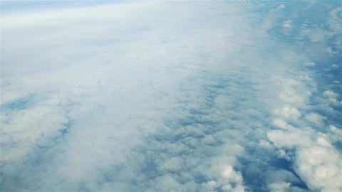 Above Puffy Clouds Footage