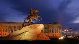 Nightfall shot of Bronze Horseman sculpture against Senate and Synod building Footage