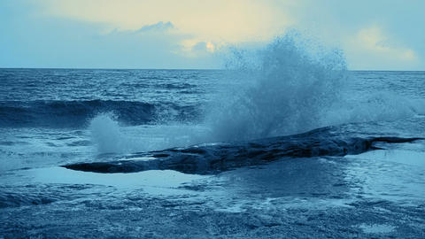 Surf Wave Crashing on Coastal Rocks. Tinted. Slow Motion Footage
