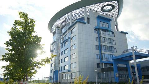 Big Beautiful Modern White Blue Building against Sun Beams Footage