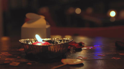 Burning candle on the table at evening event Footage