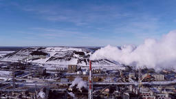 Industrial area, aerial footage through the smoke Filmmaterial