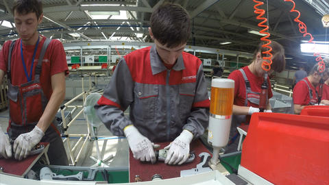 Young Worker in Grey and Red Jacket Assembles Drill Footage