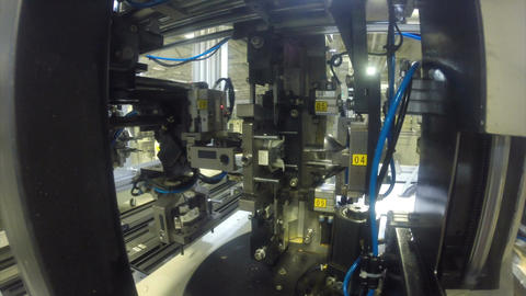 Closeup Automatic Machine Operates in Production Workshop Live Action
