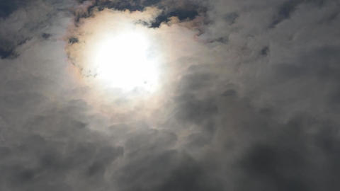 sun shines through the dark clouds time lapse Footage