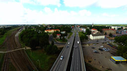 Camera follows cars, on the bridge. Aerial footage Image