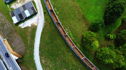 Arial footage of train on the railroad. Empty train from the top Footage