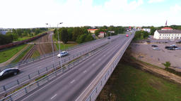 Camera follows cars, on the bridge. Aerial footage Footage