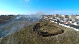 Burning grass at backyard. Garages. Aerial footage Image