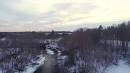 Winter landscape. Sunset at river and forest. Aerial footage. Low altitude Archivo