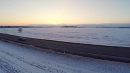 Winter road. Aerial footage. White fields covered with snow. Sunset Image