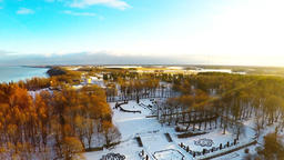 Winter landscape. Aerial footage. Sunset. River and sea coast. Camera tilt down Footage