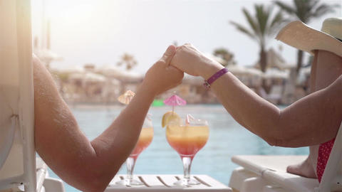 Video of senior couple holding hands in real slow motion Filmmaterial
