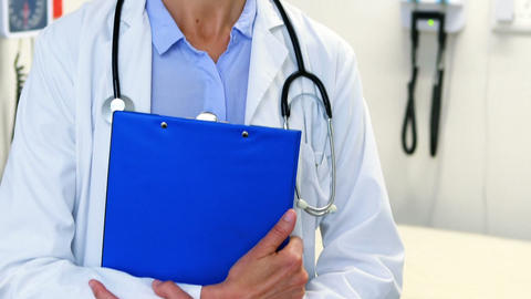 Female doctor holding clipboard Footage