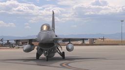 A Singaporean air force pilot taxis an F-16 towards the runway Footage