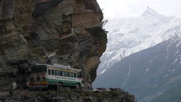 Bus On Small Road Through Rocky Mountains,Kalpa,Kinnaur,India stock footage