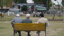 3 Men On Bench In Front Of The Central Market,Srinagar,Kashmir,India stock footage