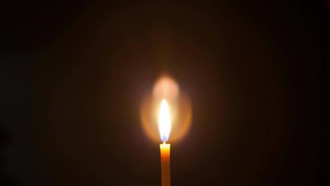 Burning church candle Archivo