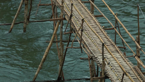Bamboo bridge over river in Luang Prabang Footage
