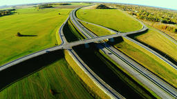 Highway trough green fields. Aerial footage Footage