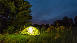 Moving stars and clouds above tent at night. Night time lapse Footage