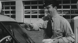 USA 1950s: Gas Station Attendant Fills Gas Tank, Washes Windshield Footage