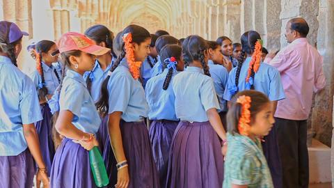 Teacher Explains History to Schoolgirls by Terrace Wall Footage