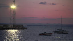 Boats in the sea with purple sky background 4 Footage