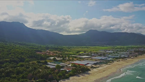 Aerial View Motion from Ocean to Beach and Mountains