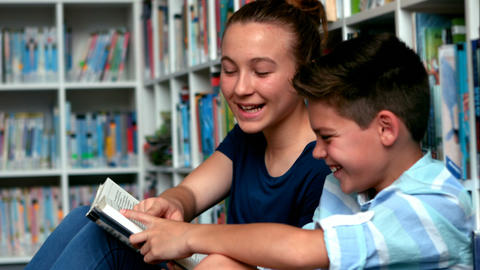 School kids reading books in library at school Footage