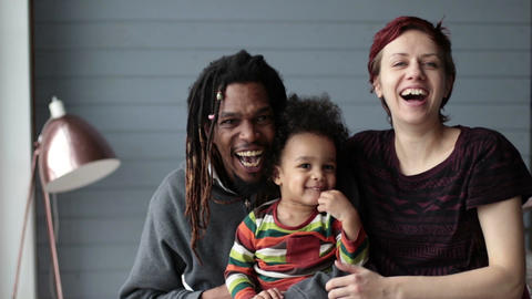 Portrait of beautiful mixed race family smiling Footage