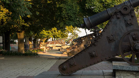 Time-lapse historical sight, military old cannon on the shaft Archivo