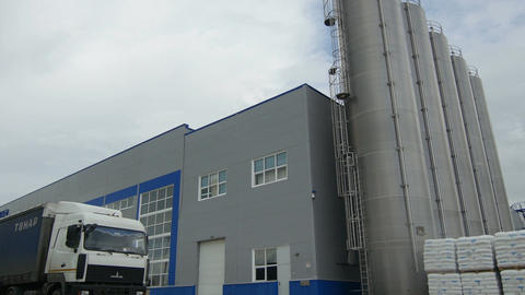 Industrial Building with Large Towers Truck on Foreground Footage