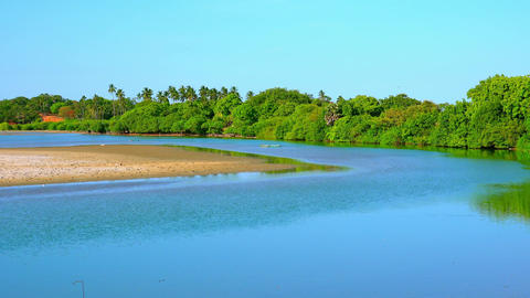 Pure beauty of Sri Lankan nature. Amazing tranquil landscape with blue river Footage