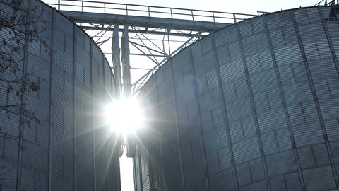 Industrial Grain Silos With Sun Flare Timelapse Footage