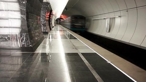 Metro train arrives at an empty subway station Footage