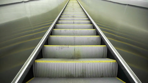 Upward movement standing on an empty escalator Filmmaterial