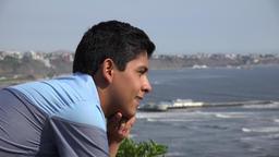 Teen Boy Staring At Ocean Footage