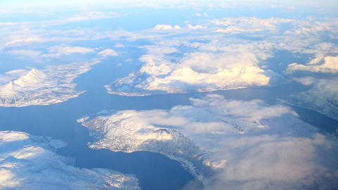Aerial view over the snowy mountains of Northern Norway in the Arctic Circle dur Footage
