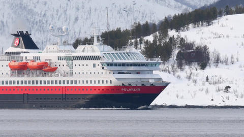The Hurtigruten cruise ship 'Polarys' sailing in a Fjord near the city of Troms Footage