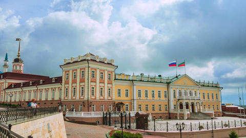 Timelapse Camera Moves along Public Building with Russian Flags Footage